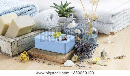 Bath Spa Setting With Natural Soaps. Lavender Spa Treatment, Towels, Sea Salt And Dried Herbs. Aroma