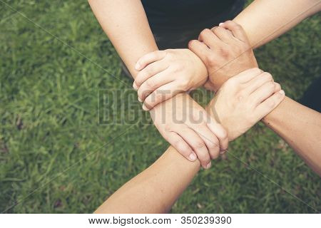 Concept Partnership. Group Of Photographers  Partners Team With Hands Together Trusted Each Friends.