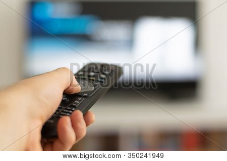 Hands Holding Remote Controller. Hand Holding Tv Remote Controller. Hand Typing On Remote Controller