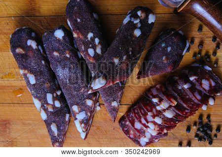 Dried Pork Sausages Composition On A Wooden Background