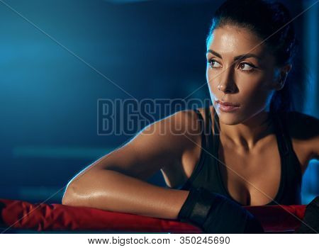 Close Up Of Young Professional Female Kickboxer With Strong Face Wearing Trendy Sports Outfit And Ba