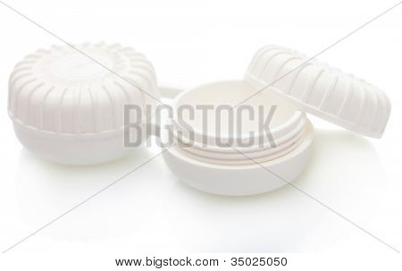 containers for contact lenses isolated on white
