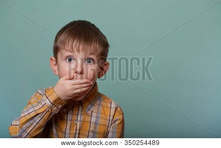 The Child, A Boy In A Yellow Shirt, Was Frightened And Put His Hand Over His Mouth. Looks At The Cam