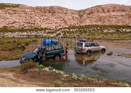 An Off-road Vehicle Stuck In Quicksand In The Canyon Del Rio Anaconda In The Bolivian Plateau. Lands