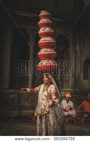 Udaipur, Rajasthan / India »; August 2016: A Traditional Dancer With Many Vases On Her Head