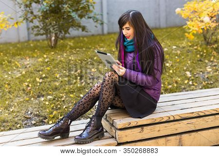 Technologies, Urban And People Concept - Student Young Woman Reading An Ebook Or Tablet In An Urban