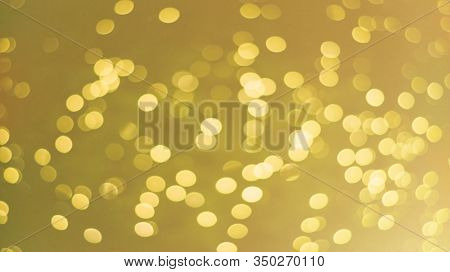 Yellow Background With Bokeh Effect. Dark Yellow Wheat Color Or Ocher. Summer, Sand Motif And Sun Gl