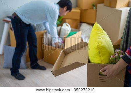 Woman Is Carrying The Box For Personal Items. Prepare To Move To A New Home.