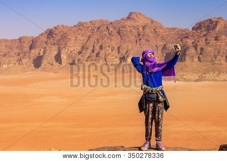 Caucasian Travel Girl With Eastern Traditional Hijab Making Selfie Staying On Edge Of High Cliff Wit
