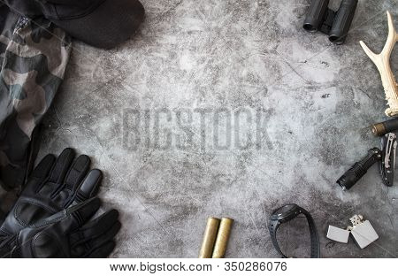 Hunting Accessories On A Dark Background, Tactical Equipment. Hunting Tactical Background. The Conce