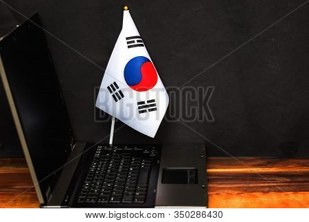 Flag Of South Korea, Computer, Laptop On Table And Dark Background