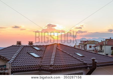 Cityscape Landmark Shingles Roofs And Evening Sunset Rays Light And Glare Copy Space