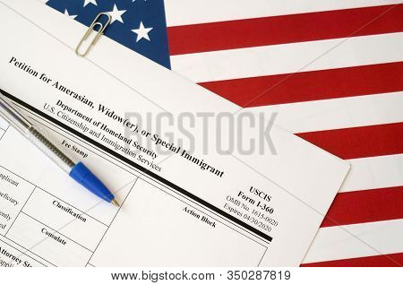 I-360 Petition For Amerasian, Widower Or Special Immigrant Blank Form Lies On United States Flag Wit
