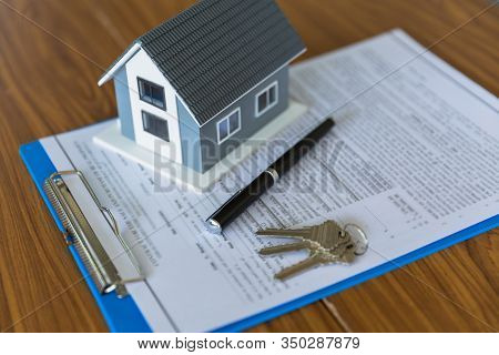 The  Gray Roof House Is Placed On The Agent's Contract. Contract Contracts, Signatures On Documents,