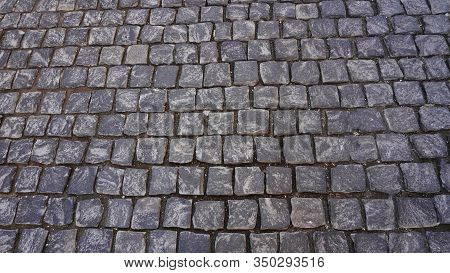 Granite Cobblestone Sidewalk Cubic Stone Close Up Background Texture. Street Pavement Texture