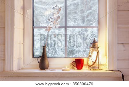 Festive Lantern, Red Mug And Heart On A Wooden Window Sill In Winter Indoors.