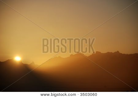 Winter Sunrise Over The Alps And Mountain Silhouette