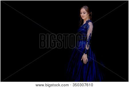 Close Up Portrait Of Beautiful Teen Girl In Beautiful Ultramarine Prom Dress Prom Dress. Black Backg