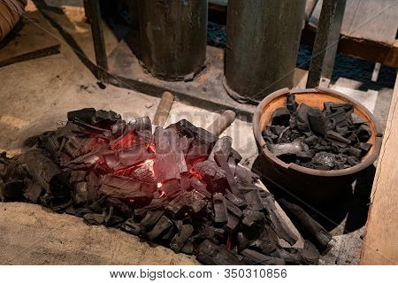 Charcoal Stove Air Blow Pump For Melt Metal Brass Casting. Close Up Of Charcoal For Burn Metal.