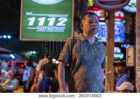Thailand, Phuket, Patong, February 1, 2020: An Asian Man, Thai Or Chinese, Walks The Streets Of Pato