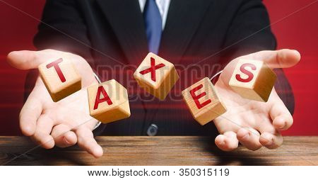 Cubes Thrown By Official Or Businessman Make Up Word Taxes. Income Declaration, Tax Payment, State A