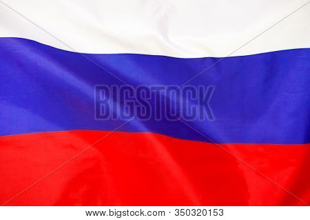 Fabric Texture Flag Of Russia.the Colorful Flag Of Russia Waving In The Wind. Russia Flag Is Depicte
