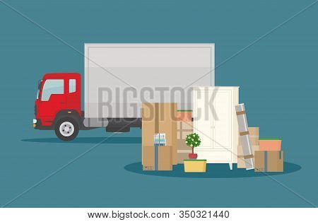 Moving Into New House. Delivery Truck, Furniture And Cardboard Boxes. Isolated On Dark Blue Backgrou