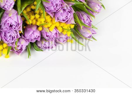Bouquet Of Lilac Tulips And Yellow Mimosas On White Background, Copy Space, Side View, Closeup. Marc