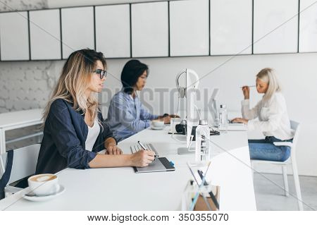 Indoor Portrait Of Young Web-developers Of International Company Having Coffee Break. Blonde Designe