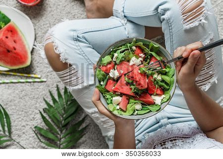 Woman In Jeans Eating Fresh Summer Watermelon Salad With Feta Cheese With Smoothie On Light Backgrou