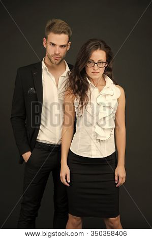 Confident Of Success. Business Partners With Confident Look. Confident Couple In Formalwear. Confide