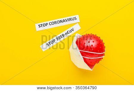 Coronavirus Model, Protective Mask, Text Stop Coronavirus On Yellow Background. Chinese Coronavirus,