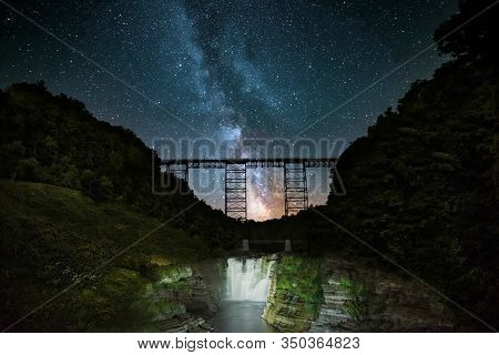 The Milk Way Over The Railroad Trestle At Letchworth State Park In New York