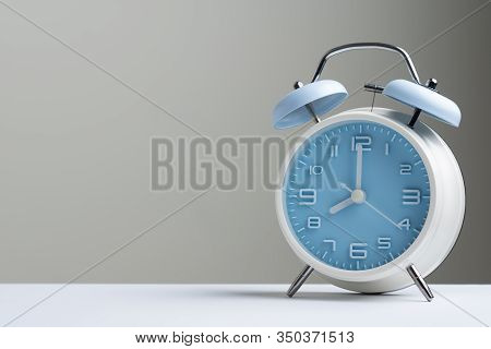Blue Color Old Fashioned Bell Alarm Clock Showing 8 Oclock Isolated On White Background