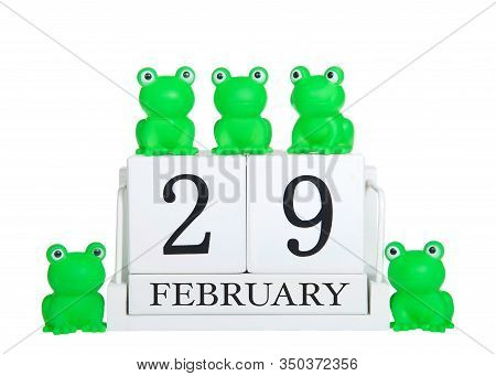 White Calendar Blocks February 29 Isolated On White Background With Generic Green Frogs On And Aroun