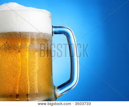 Mug Of Beer Over Blue