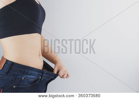 Close Up Shot Of Woman With Slim Body Showing Her Diet Results. Healthy Nutrition, Diet And Weight L