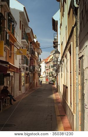 A Shady Alley In Fuengirola, Andalusia, Spain. People Are Having A Cup Of Coffee In The Shade.