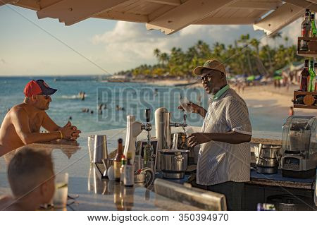 Dominican Bartender Prepares A Cocktail On The Beach 2