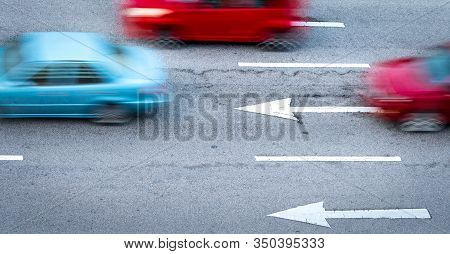 Red And Blue Car Fast Moving On Asphalt Road In The City. Blurred Motion Of Fast Speed Compact Car O