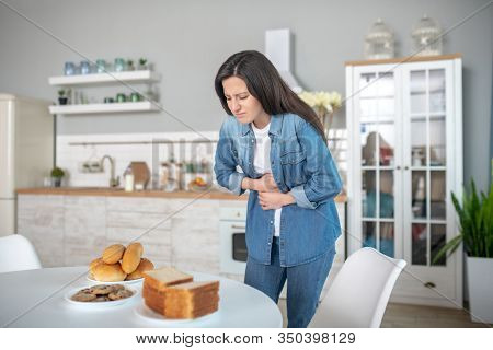 Woman Having A Stomach Ache Because Of Gluten Intolerance