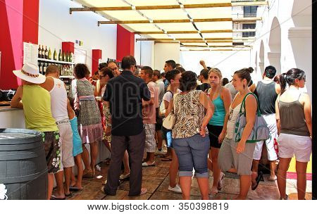 Malaga, Spain - August 18, 2008 - People Realxing At A Bar In The Plaza De La Constitucion At The Fe
