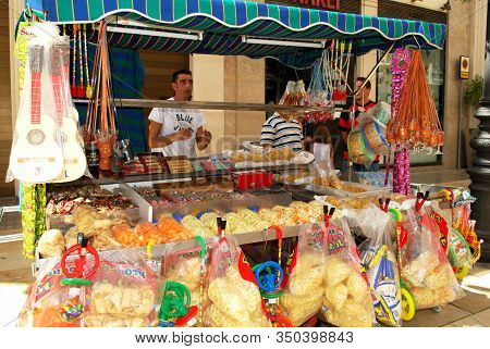 Malaga, Spain - August 18, 2008 - Street Stall Selling Snacks On Calle Marques De Larios During The
