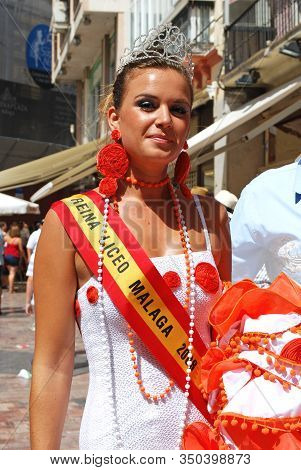 Malaga, Spain - August 18, 2008 - Beauty Queen Wearing A Sash Along Calle Marques De Larios During T