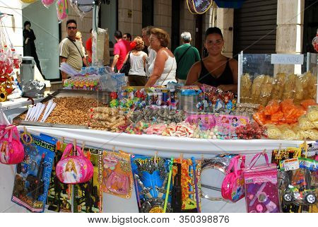Malaga, Spain - August 18, 2008 - Snack And Toy Stall On Calle Marques De Larios During The Feria De