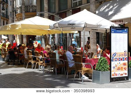 Malaga, Spain - August 18, 2008 - People Relaxing At A Pavement Cafe At The Feria De Malaga, Malaga,