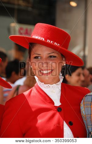 Malaga, Spain - August 18, 2008 - A Woman Wearing A Red Tio Pepe Outfit At The Feria De Malaga, Mala
