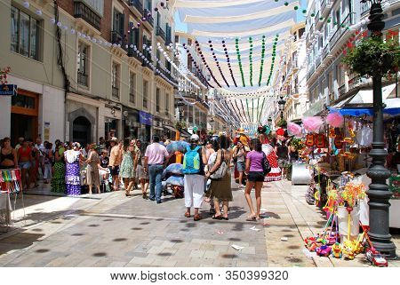 Malaga, Spain - August 18, 2008 - People Enjoying The Festivities Along Calle Marques De Larios At T