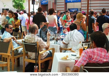 Malaga, Spain - August 18, 2008 - People Relaxing At A Pavement Cafe During The Feria De Malaga, Mal
