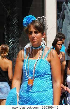 Malaga, Spain - August 18, 2008 - Woman In Traditional Dress Along Calle Marques De Larios At The Fe